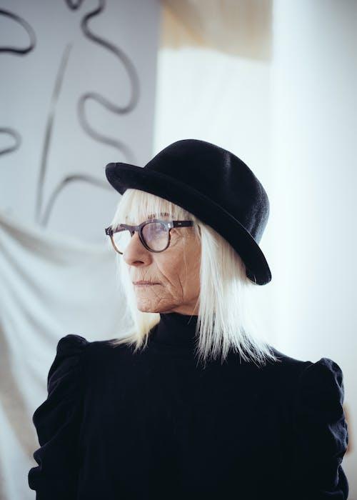 Portrait Photo of Woman in Black Coat Wearing Black Hat