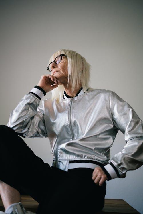 Woman in Gray Zip Up Jacket Wearing Eyeglasses