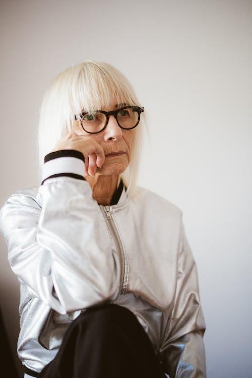 Woman in White Zip Up Jacket Wearing Black Framed Eyeglasses