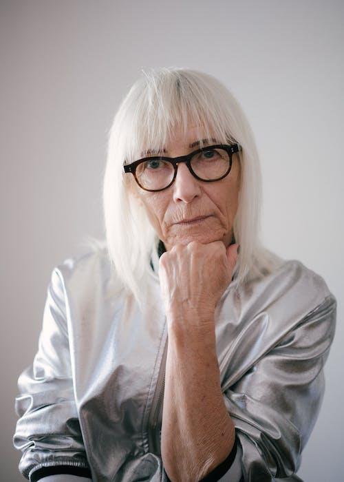 Portrait Photo of Woman in Gray Zip-up Jacket  Wearing Eyeglasses