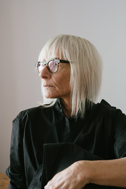 Elderly Woman in Black Jacket Wearing Black Framed Eyeglasses