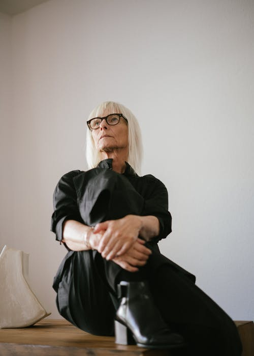 Woman in Black Long Dress Wearing Eyeglasses