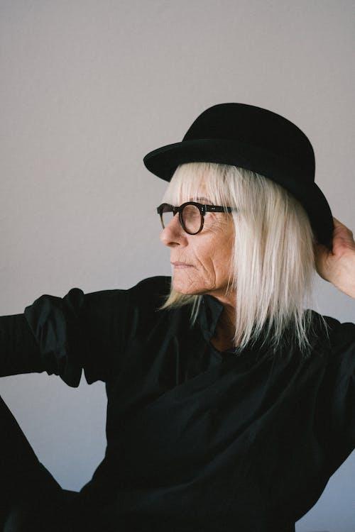 Woman in Black Long Sleeve Shirt Wearing Black Fedora Hat