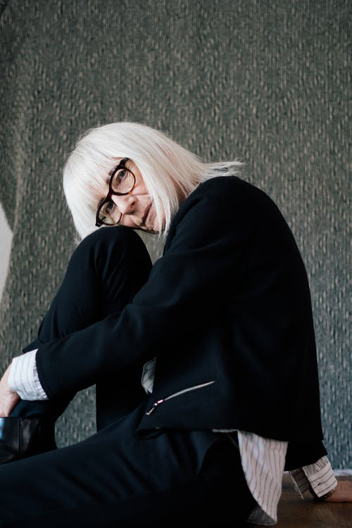 Stylish aged woman in classy suit