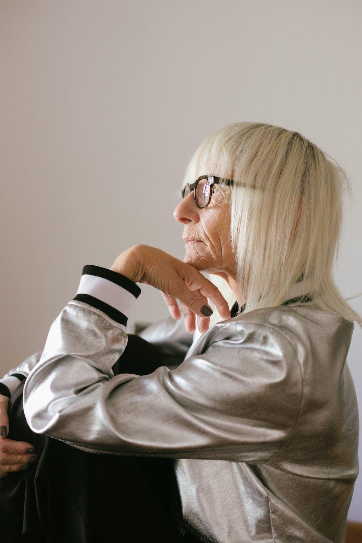 Elderly woman in eyeglasses and trendy bomber. | Photo: Pexels