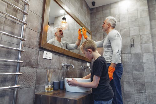 Dad with kid tidying up bathroom