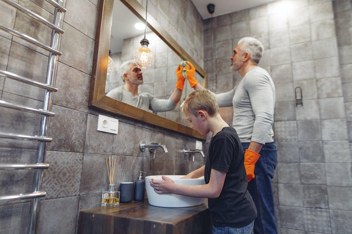 Dad with kid tidying up bathroom