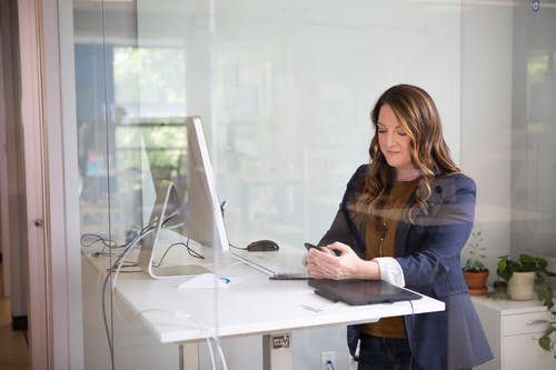 Woman in Black Blazer Using Macbook Air