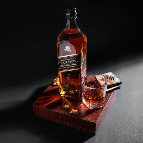 Free stock photo of alcohol, alcohol bottle, alcoholic beverage, amber