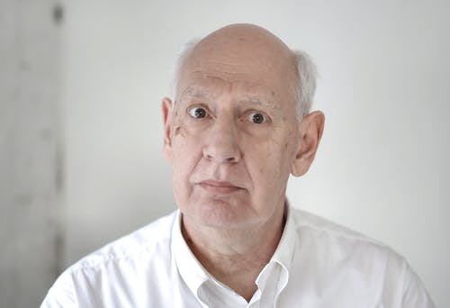 Portrait Photo of an Elderly Man in White Dress Shirt