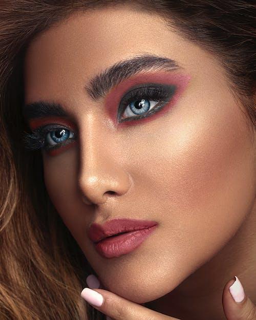 Close-up Photo of Woman Wearing Pink Lipstick