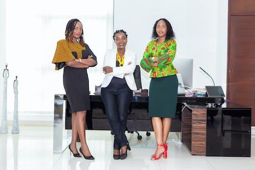 3 Women Sitting on Black Wooden Table
