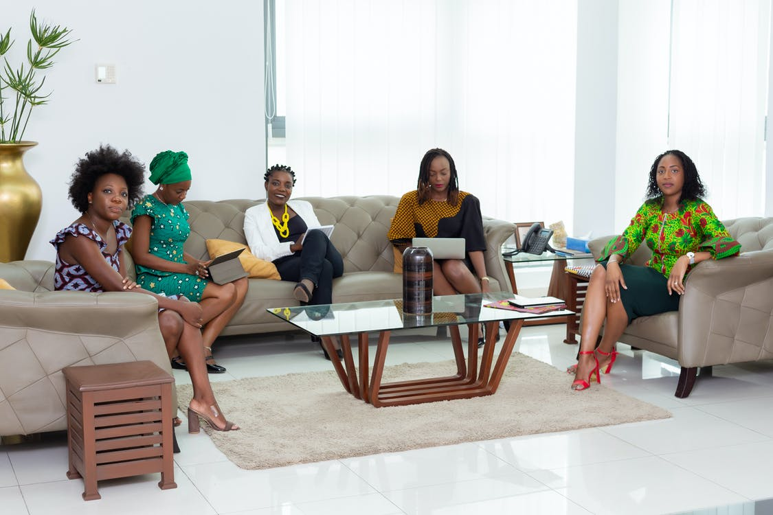 Group of Women Sitting on Couch