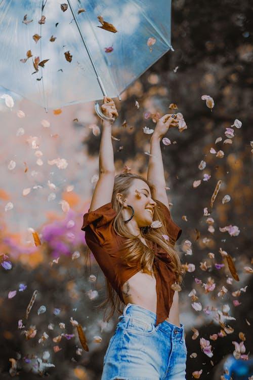 Photo Of Woman Holding Umbrella