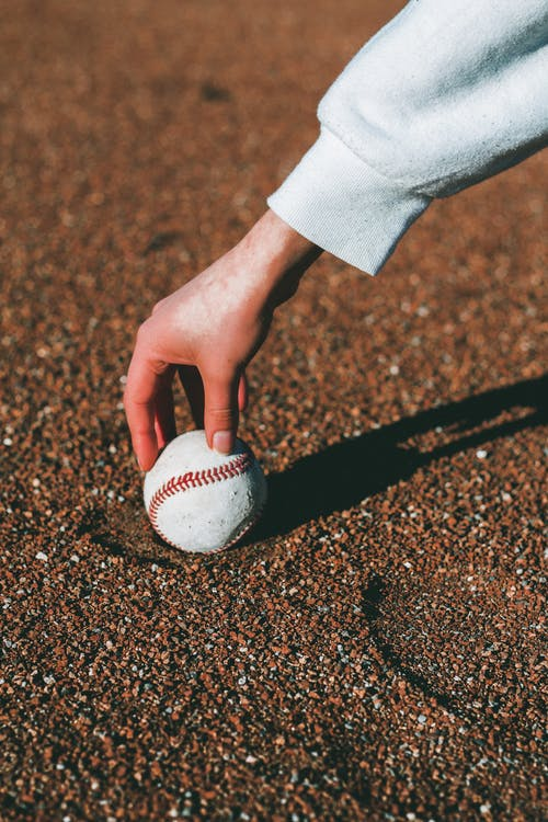 Photo Of Person Holding Baseball