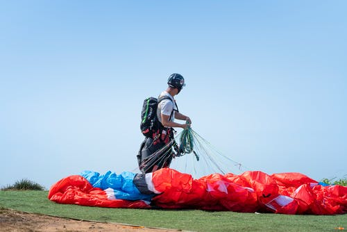 Photo Of Person Holding Parachute