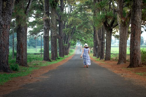 Photo Of Woman Walking On The Road
