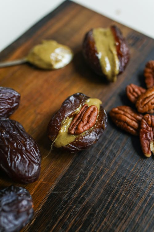 Photo Of Pecan On Wooden Surface