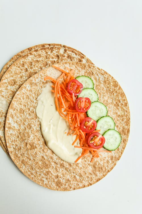 Photo Of Sliced Tomatoes On Pita Bread