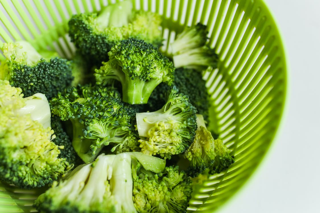 Close-Up Photo Of Broccoli On Green Tray