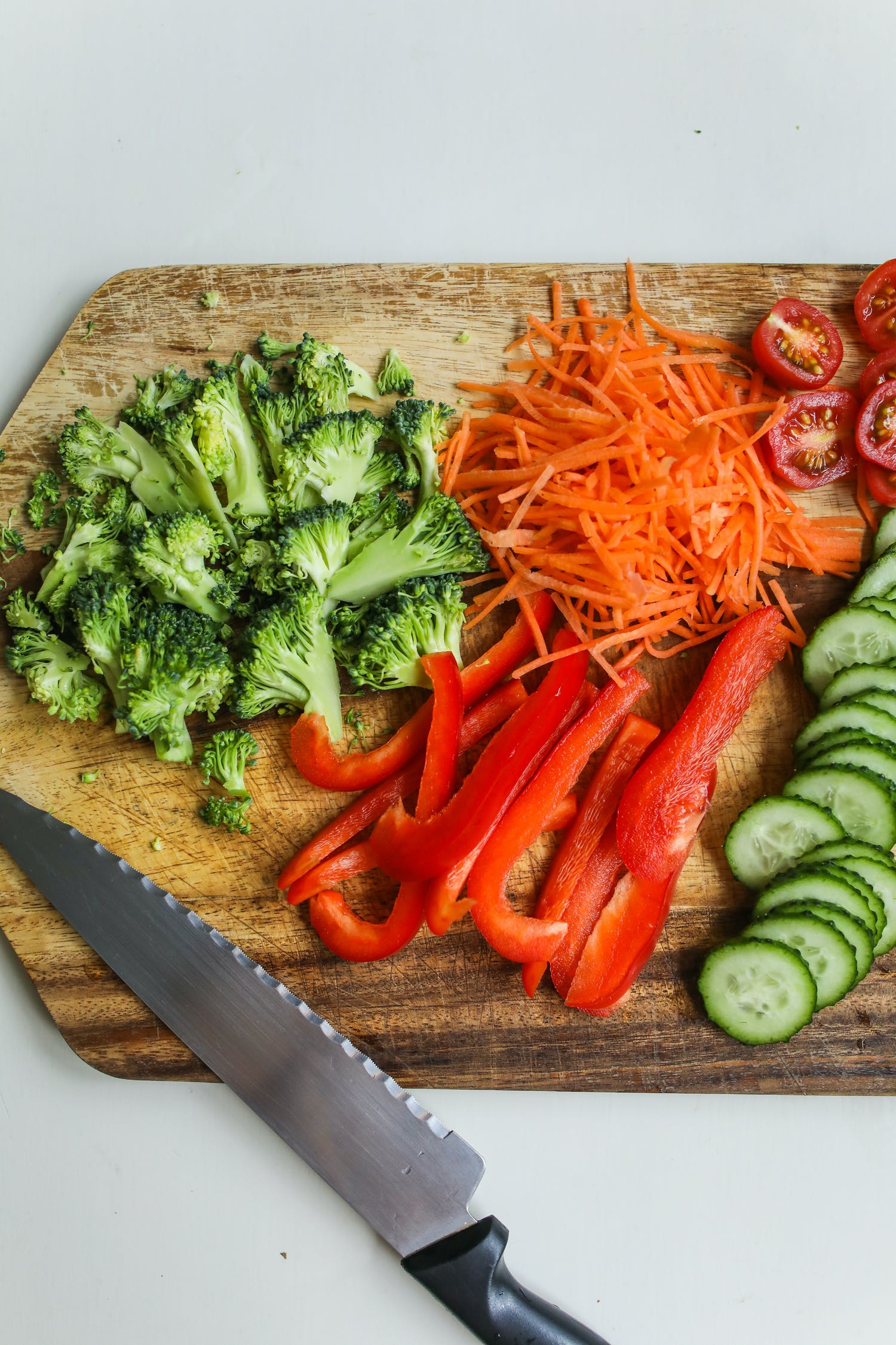 Photo Of Sliced Vegetables On Wooden Chopping Board