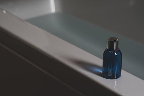Blue Nail Polish Bottle on White Ceramic Sink
