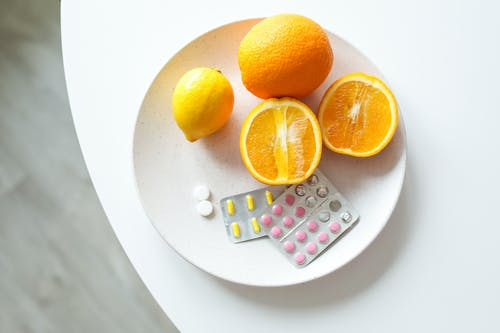 Photo Of Orange Fruit On Plate