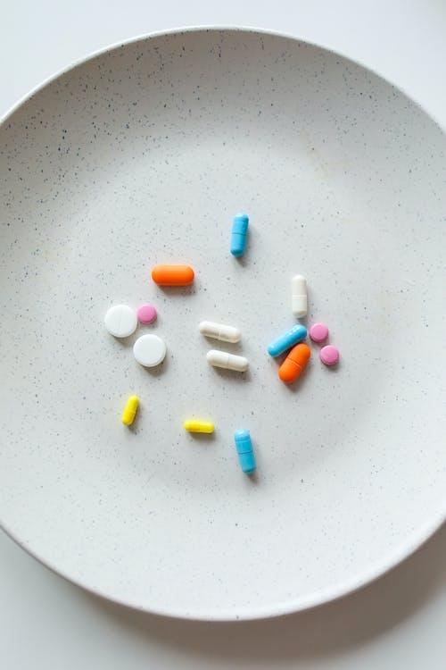 Бесплатное стоковое фото с витамины, здоровье, здравоохранение, капсулы
