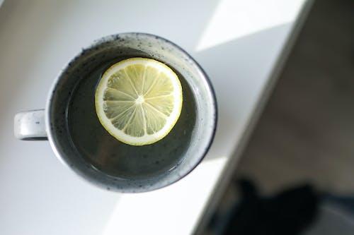 Close-Up Photo of Mug With Sliced Lemon