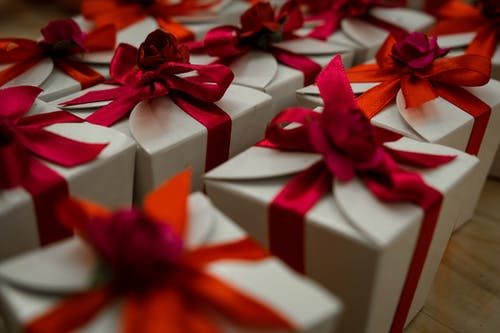 White and Red Gift Box With Red Ribbon