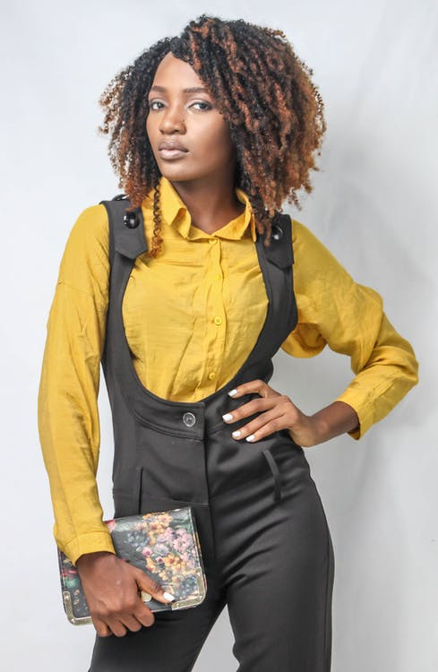 Woman in Yellow Shirt and Black Dungaree