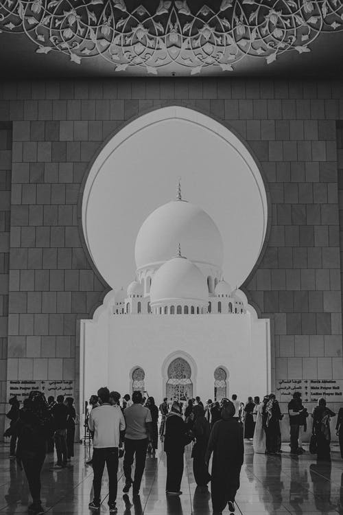 People Standing in Front of White Dome Building