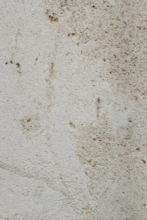 Old stone textured wall with shabby surface