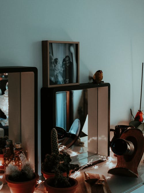 Black Wooden Framed Mirror on Brown Wooden Table