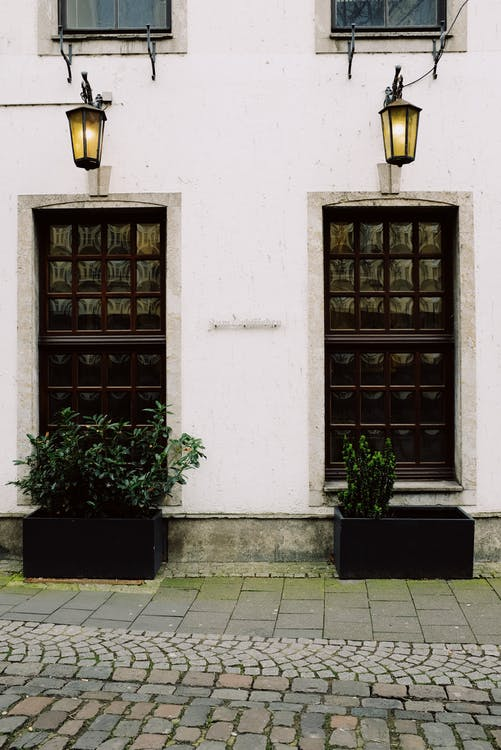 Old stone building with decorative doors in historical city