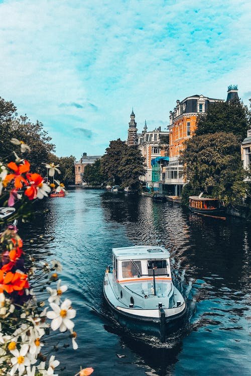 Boat floating on calm city canal