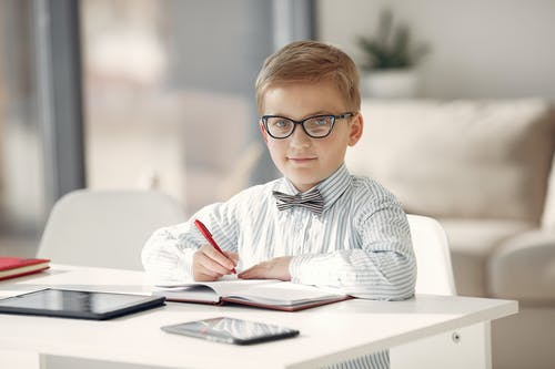 Boy in Black and White Striped Dress Shirt Wearing Eyeglasses