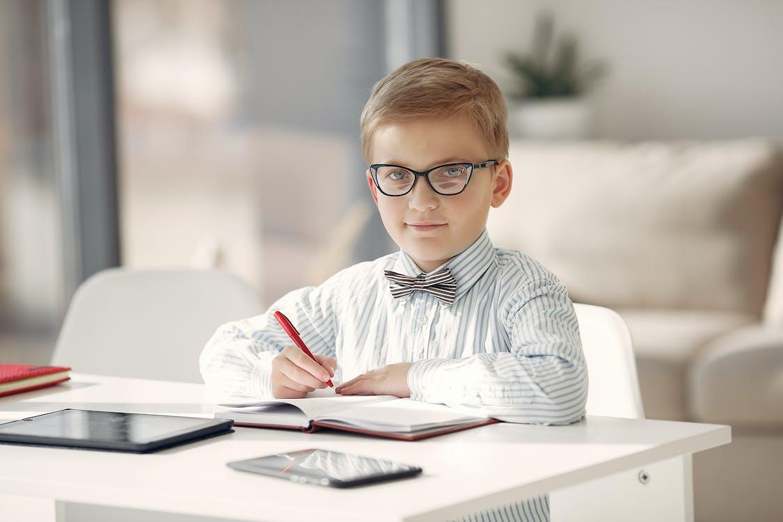 Boy in Black and White Striped Dress Shirt Wearing Eyeglasses