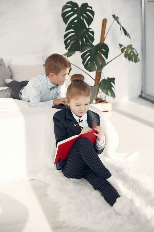 Positive little business children during remote job at home