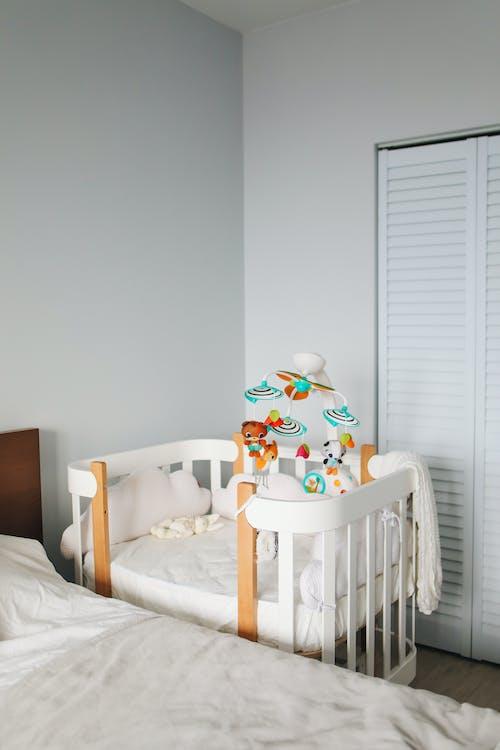 White crib in bright bedroom
