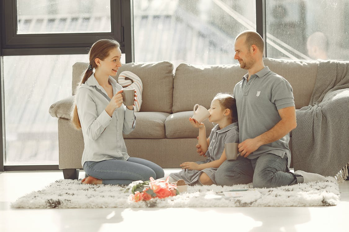 Happy family having fun in living room at home