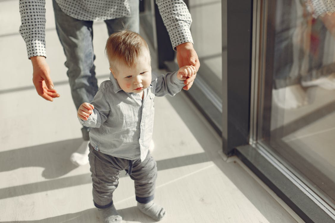 Little Baby Boy Standing And Learning To Walk