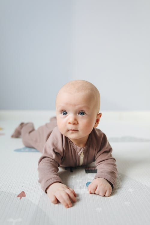 Photo of Baby Lying On bed