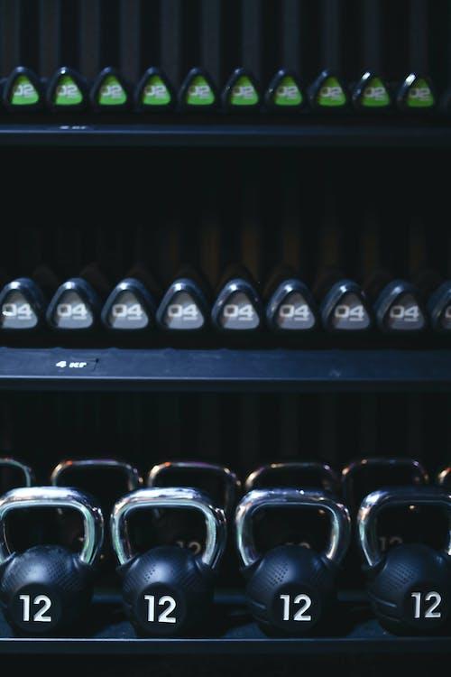 Set of kettlebells on shelves in gym