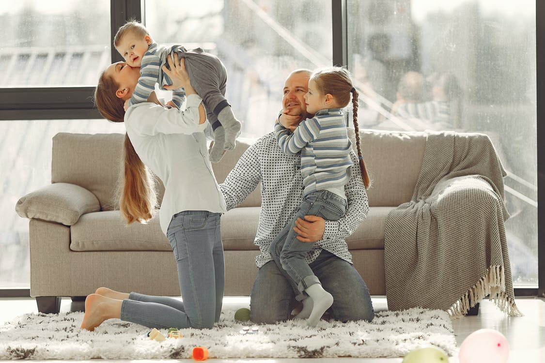 Happy family embracing while spending time at home