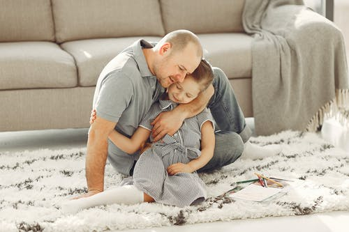Man Hugging Her Daughter