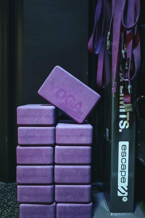 Set of violet yoga blocks and belts