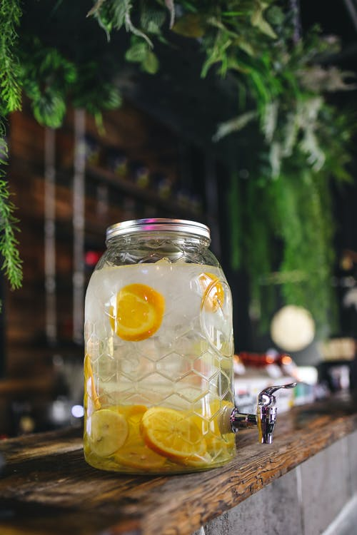 Clear Glass Jar With Water and Lime slices Inside