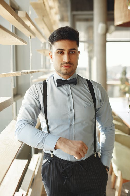 Man in White Dress Shirt and Black Bow Tie