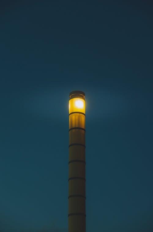Modern beacon against night sky